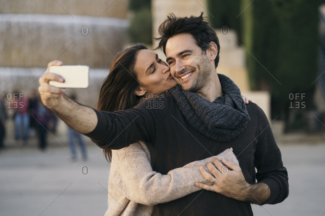 Couple in love taking selfie with cell phone
