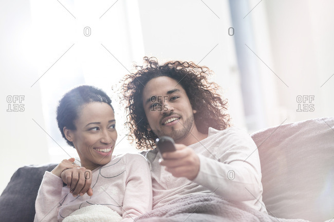 Relaxed couple at home watching Tv
