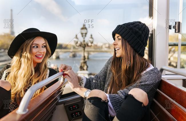 France- Paris- two smiling women on a tour bus