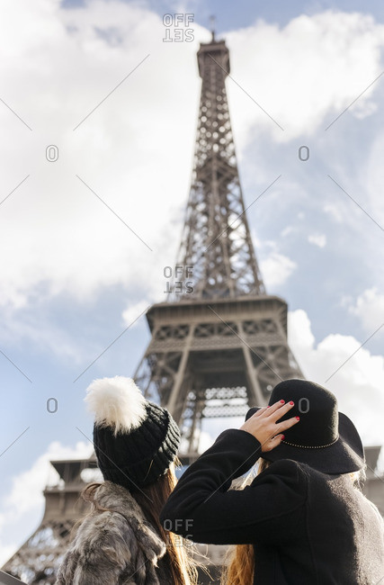 France- Paris- two women looking at the Eiffel Tower