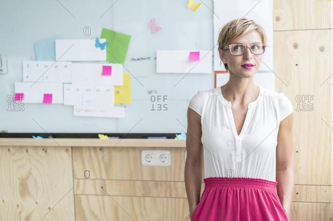 Businesswoman in front of whiteboard in modern office