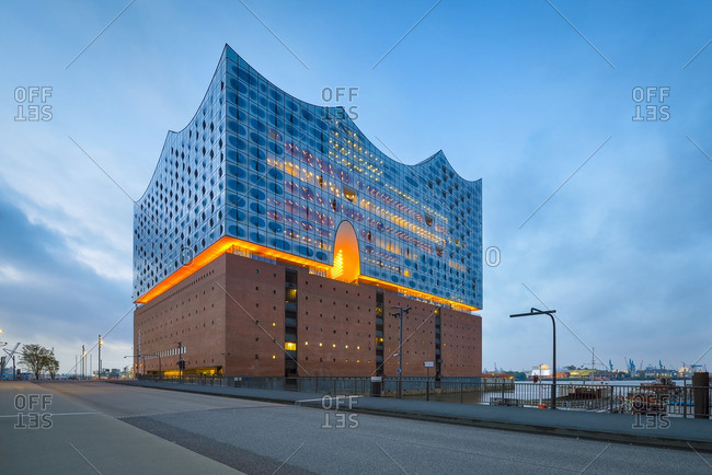 Lighted Elbe Philharmonic Hall at morning twilight