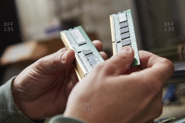 Hand holding used RAM
