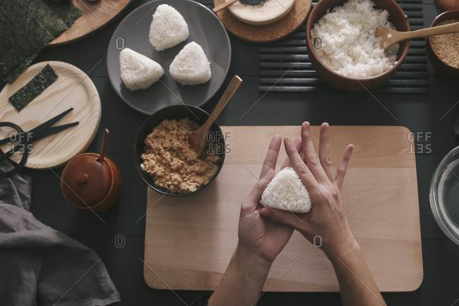 Woman's hands preparing Onigiris