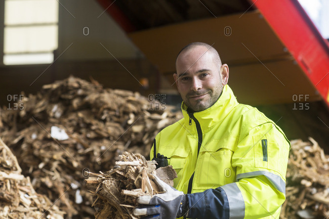 Portrait of content worker at wood recycling yard