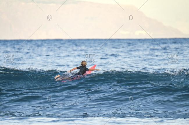 Spain- Tenerife- boy surfing in the sea