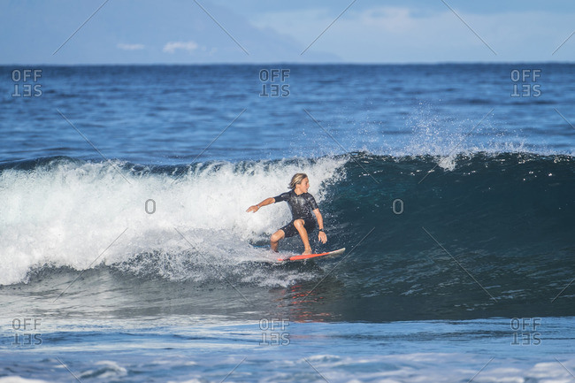 Spain- Tenerife- boy surfing in the sea