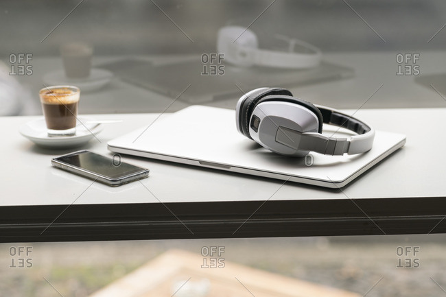 Espresso- smartphone- laptop and headphones