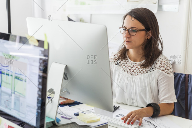 Landscape architect working with computer at desk