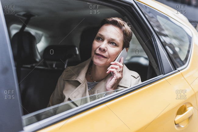 Woman in taxi on cell phone