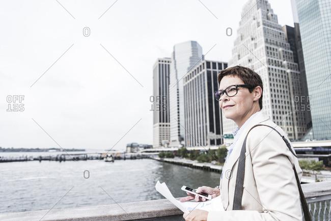 USA- New York- Businesswoman walking in Manhattan