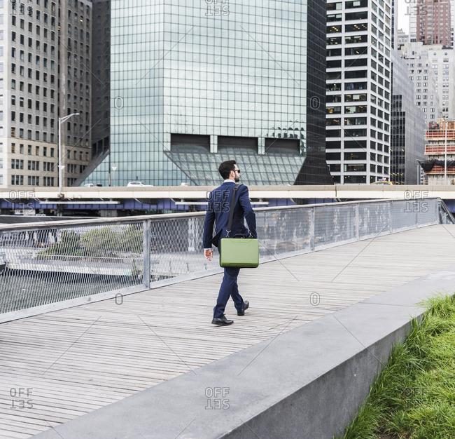USA- New York- Manager walking in Manhattan