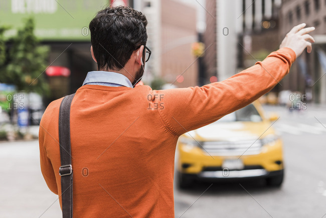 USA- New York City- Businessman hailing cab