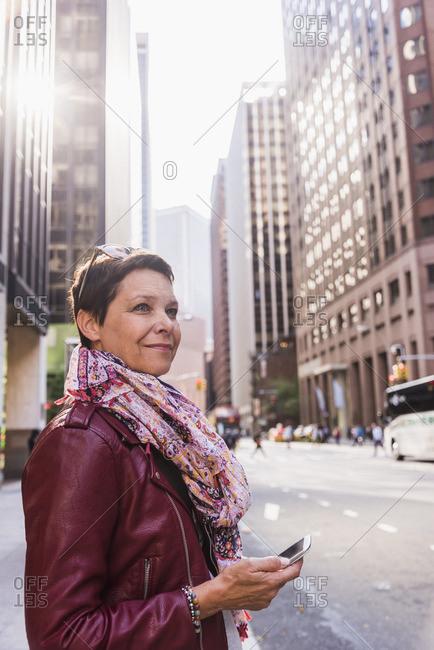 USA- New York City- smiling woman in Manhattan