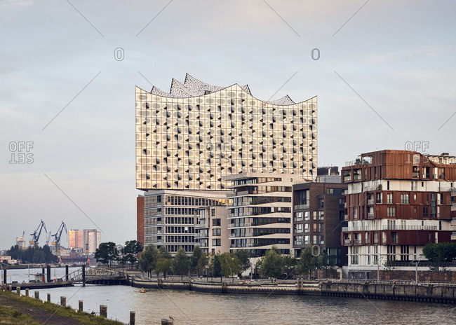 Germany- Hamburg- Hafencity- view to Elbe Philharmonic Hall with multi-family houses in the forekground