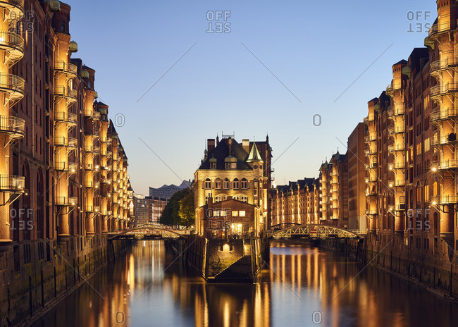 Germany- Hamburg- Speicherstadt- lighted old buildings with Elbe Philharmonic Hall in the background