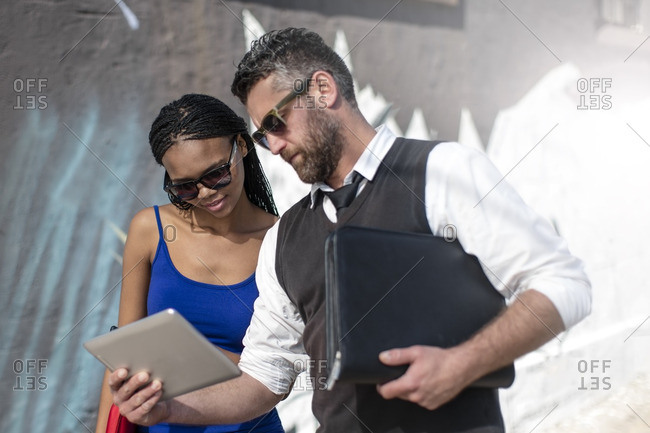 Man and woman looking at tablet together
