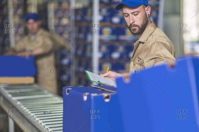 Man working at packing station of orange plantation