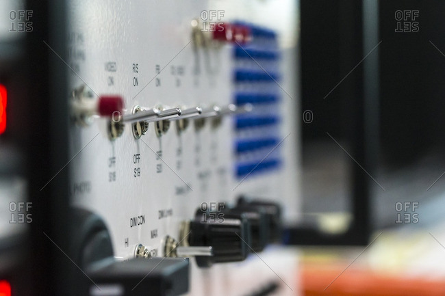 Close-up of control switches and knobs on an electronic device