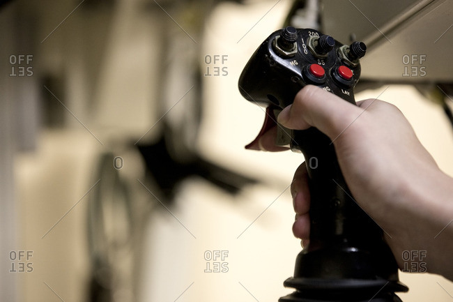 Hand on an instrument control stick