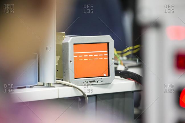 Electronic instrument showing orange screen