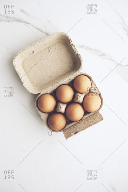 Half a dozen eggs in a carton