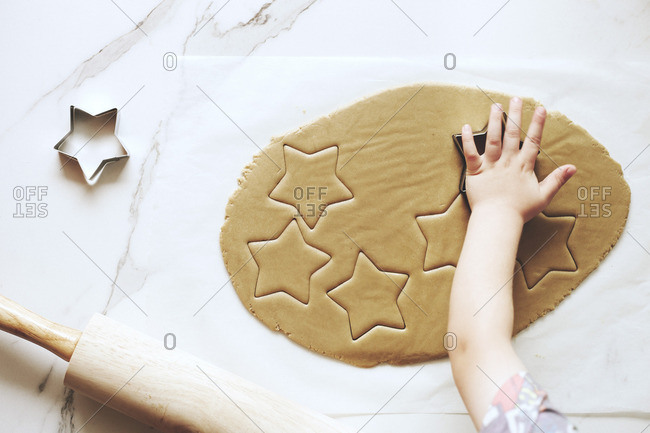 Young boy making Christmas cut-out cookies