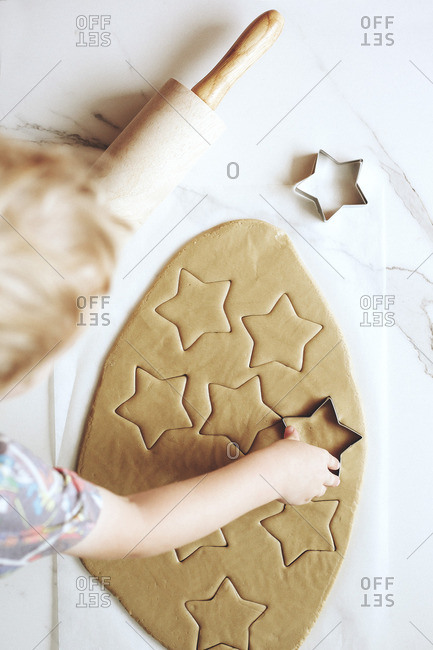 Young child making Christmas cut-out cookies