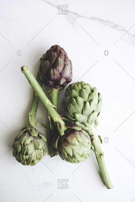 Artichokes on a marble counter
