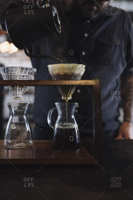 Barista making pour over coffee