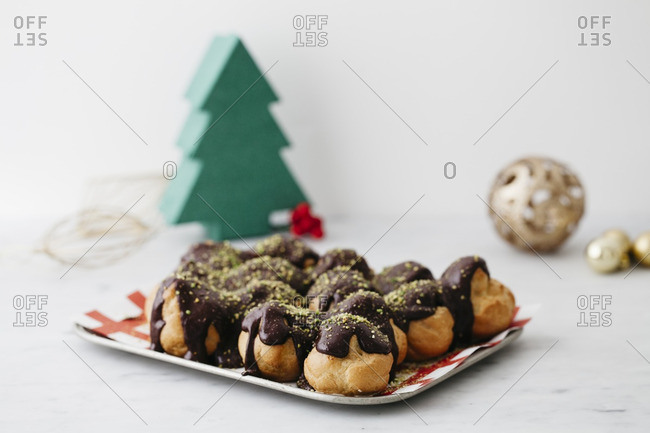 Chocolate covered puff pastries in Christmas setting