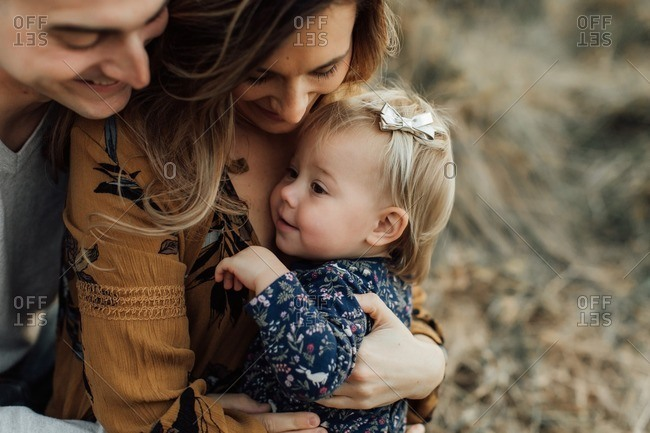 Portrait of parents with toddler daughter