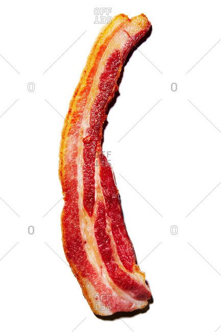 Single slice of cooked bacon