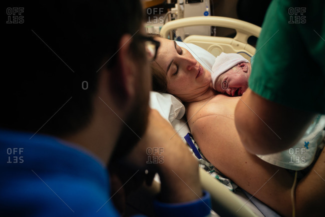 Newborn on mother's chest in hospital
