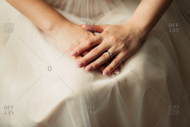 Bride's hands resting in her lap