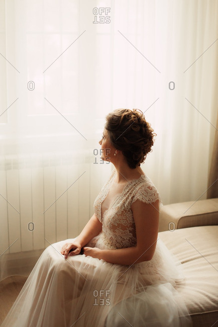 Portrait of seated bride in a classic lace dress