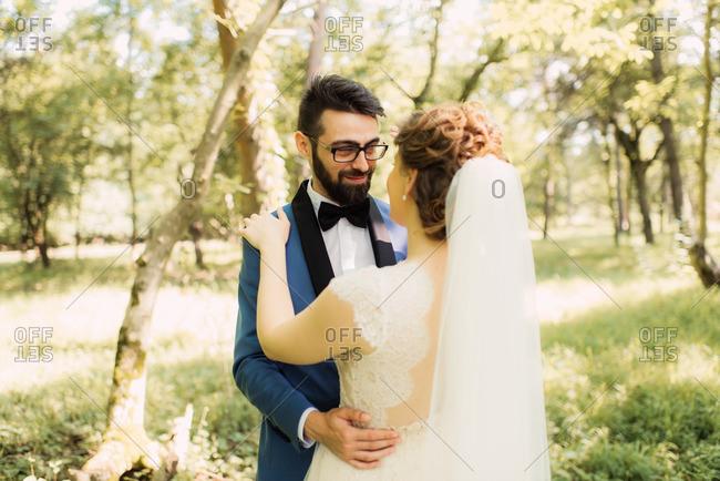 Groom gazing adoringly at bride