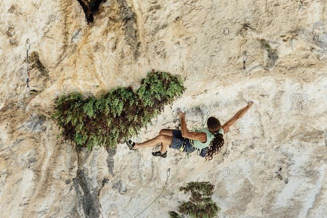 Rock climber on el Covachon cave, Spain