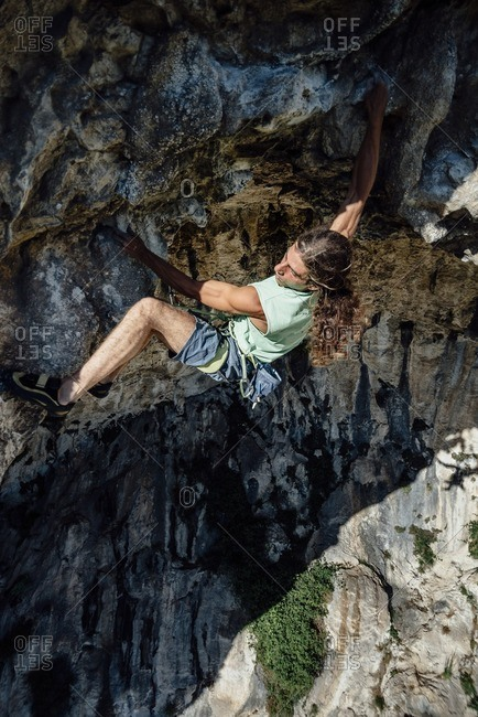 Rock climber on el Covachon cave in Spain