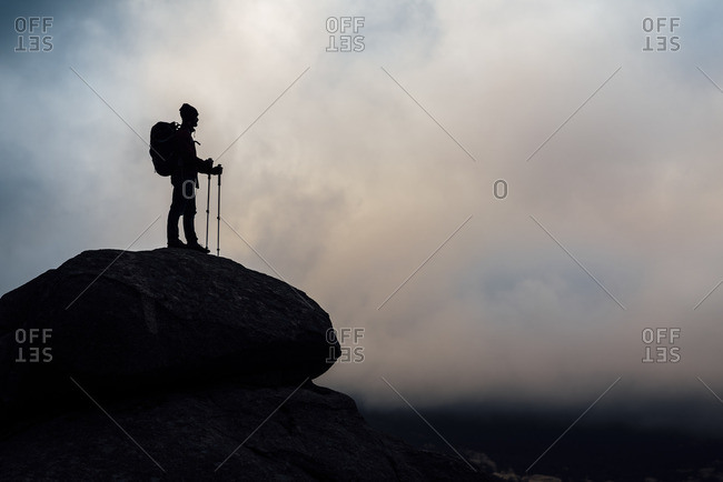Silhouette of a man hiking in remote setting