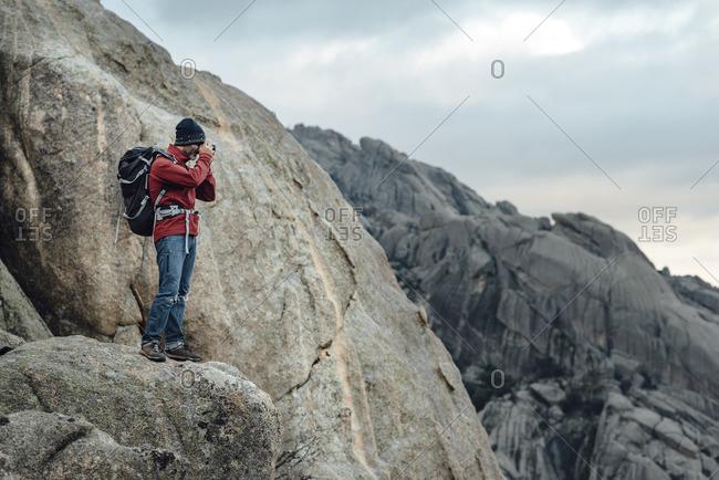 Man photographing on rock overlook