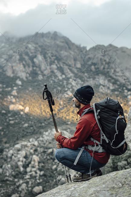 Man trekking in rocky mountains