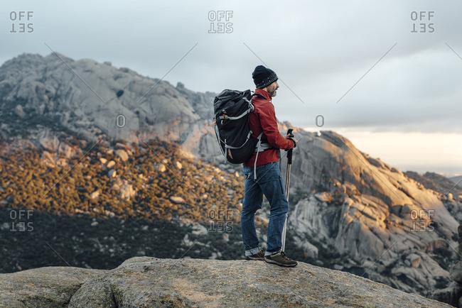 Man trekking in rocky mountain setting