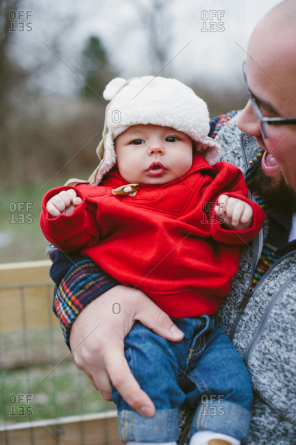 Loving dad holding baby  in winter clothes
