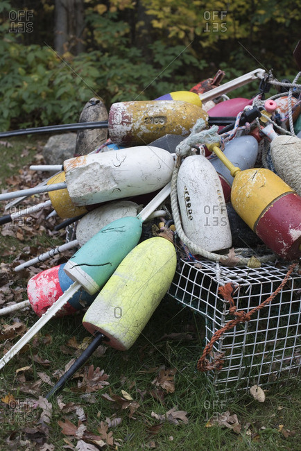 Colorful lobster buoys and traps piled on top of each other