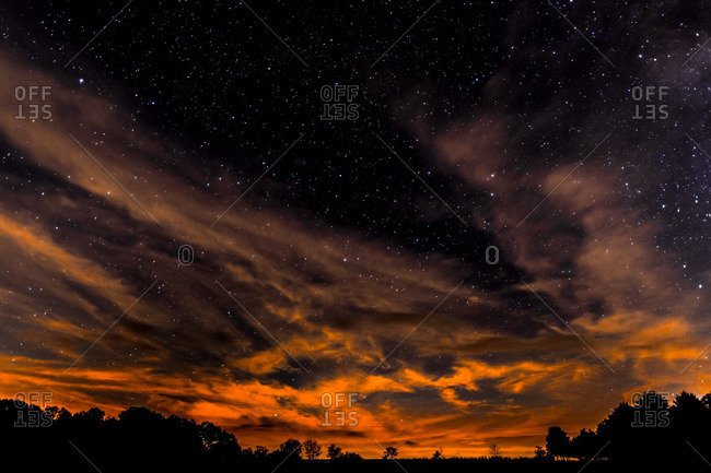 Dramatic sky glowing under stars