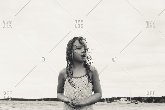 Girl with wet hair at ocean