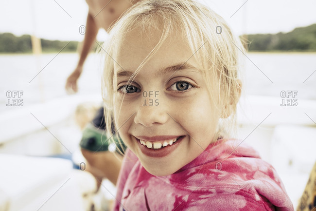 Close up of smiling girl on boat