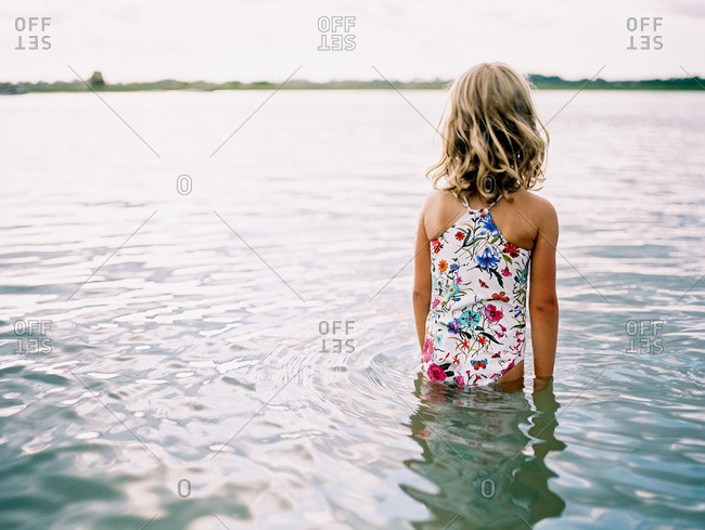 Young girl in waist-deep water