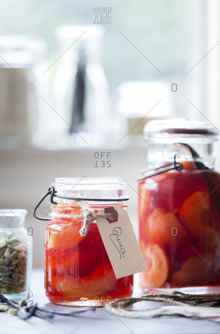 Poached quince fruit in mason jars